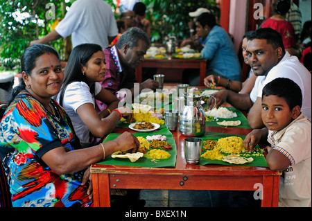 Indian family having lunch together Little India Singapore - Stock Photo