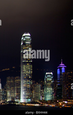 The amazing Hong Kong skyline as seen at night. The imposing structures include the ifc towers & The Centre - Stock Photo