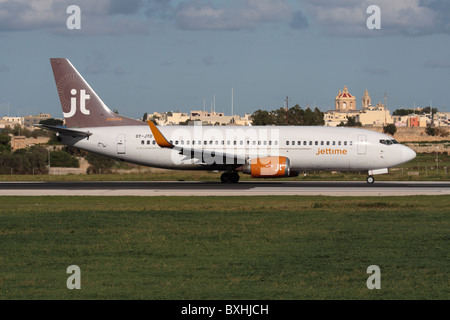 Jet Time Boeing 737-300 taxiing for departure from Malta - Stock Photo