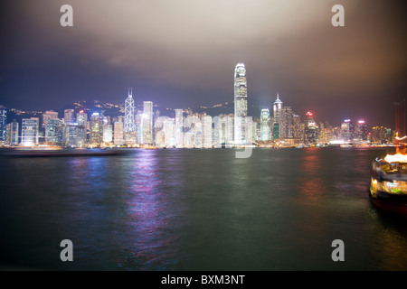 The amazing Hong Kong skyline as seen at night. The imposing structures include the two ifc towers, bank of china - Stock Photo