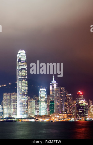 The amazing Hong Kong skyline as seen from Kowloon at night. The imposing structures include the ifc towers & The - Stock Photo
