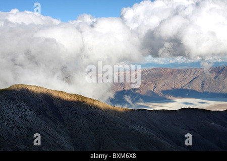 Clouds form over Badwater Basin in Death Valley National Park as seen from Mohogany Flat. - Stock Photo