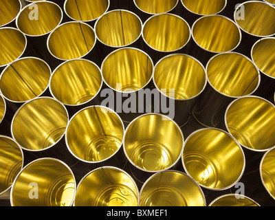 Empty cans on production line in a factory, ready to be filled. - Stock Photo