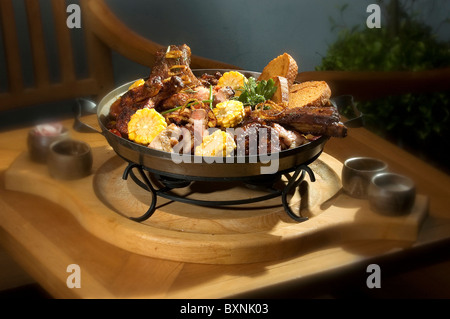 The various meat grilled on the pan w corn - Stock Photo