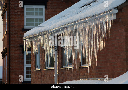 Icicles Hang From The Roof Guttering And Fascia Of A Semi