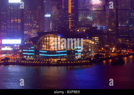 The amazing Hong Kong skyline as seen from Kowloon. The imposing structures include the  exhibition centre - Stock Photo