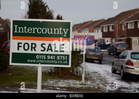Two for sale signs at neighbouring houses on a residential street in Nottingham England UK - Stock Photo