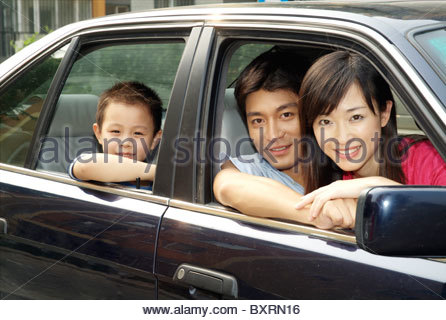 A young family in the car - Stock Photo