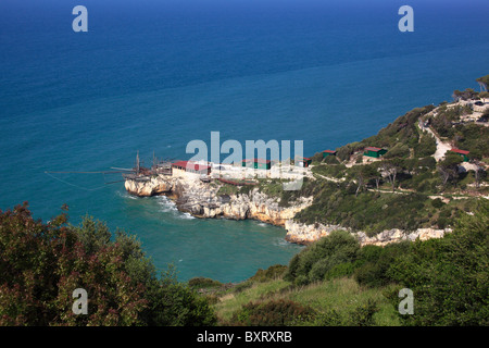 A trabucco for fishing of Monte Pucci, Peschici, Gargano Promontory, Gargano National Park, Puglia, Italy - Stock Photo