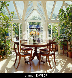 Dining Table And Chairs In Conservatory Of Green Box