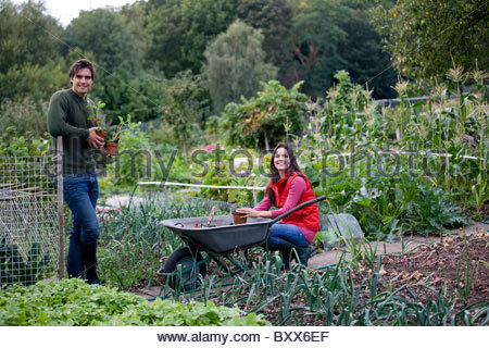 A young couple working on an allotment - Stock Photo