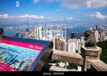 The amazing Hong Kong skyline as seen from The Peak lookout in the day, blue sky, clear summer day - Stock Photo