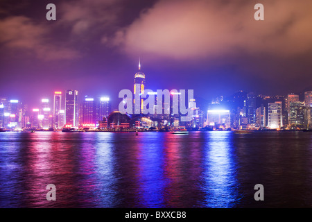 The amazing Hong Kong skyline as seen from Kowloon. The imposing structures include the Central Plaza & exhibition - Stock Photo
