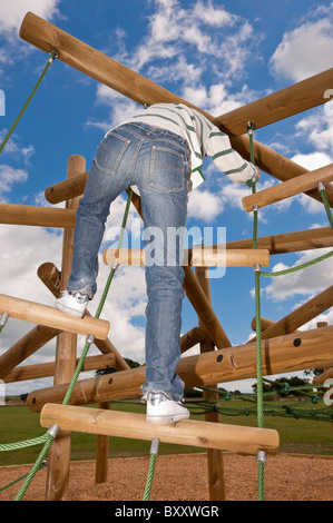 A MODEL RELEASED picture of an eleven year old boy on a climbing frame in the Uk - Stock Photo