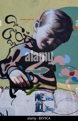 Wall mural depicting a young boy along a street in the Spanish colonial city of Santiago de Queretaro, Queretaro, - Stock Photo