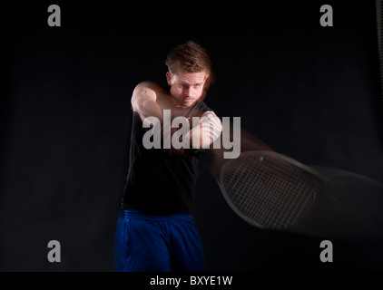 Tennisplayer in motion - Stock Photo