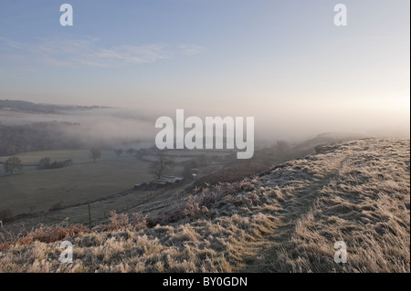 A view taken just after sunrise on a wintry  Baildon Moor. - Stock Photo