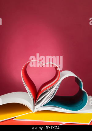 Book with opened pages and shape of heart - Stockfoto