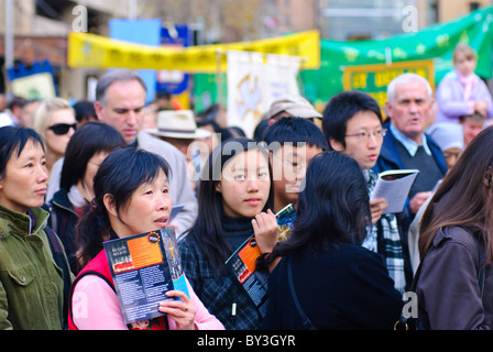 Catholic procession through city streets. Migrants from many cultures are among the people participating. - Stock Photo