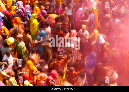 Holi festival at a temple nr Mathura, Uttar Pradesh, India - Stock Photo