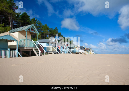 Colourful beach huts at Wells Next The Sea on the North Norfolk Coast on a summers morning - Stock Photo