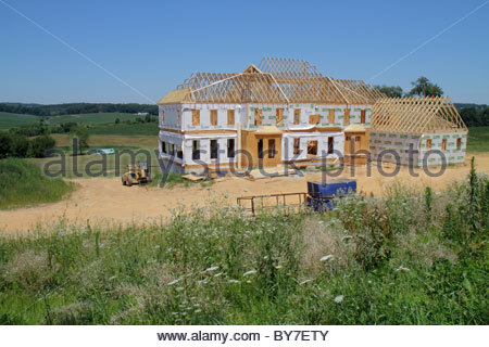 Home under construction using wood frame 2x4 s and wood for Mortgage for house under construction