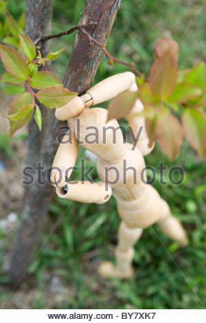 Wooden figure playing hide-and-seek - Stock Photo