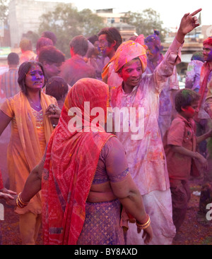 India, Rajasthan, Jodhpur, revellers during the Indian Holi festival covered in powder paint - Stock Photo