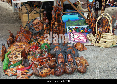 A display of colourful wooden fish for sale in a craft for Jamaica fish market