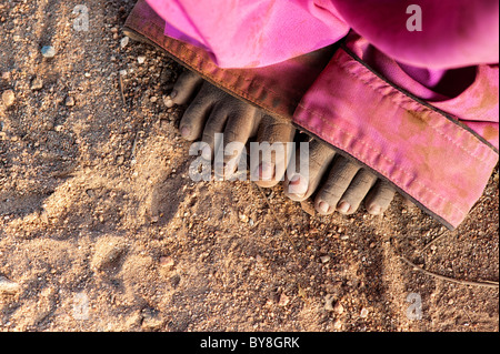 Young poor lower caste Indian street girls dirty grubby bare feet and toes. Andhra Pradesh, India - Stock Photo