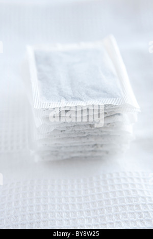 Mint tea bags on white tea towel - Stock Photo