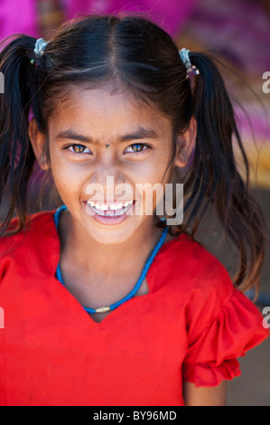 Happy young poor lower caste Indian street girl smiling. Andhra Pradesh, Indi. - Stock Photo