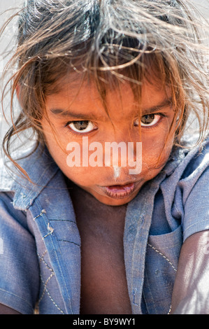 Shy happy young poor lower caste Indian street girl smiling. Andhra Pradesh, India - Stock Photo