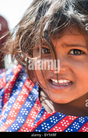 Happy young poor lower caste Indian street girl smiling - Stock Photo
