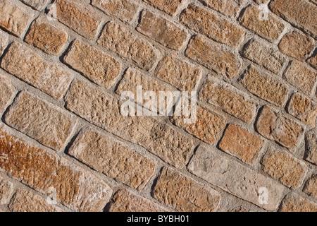 Sandstone brick wall background - Stock Photo