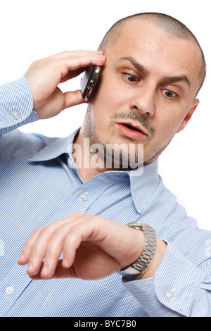 Young businessman worried looking at his wrist watch - Stock Photo