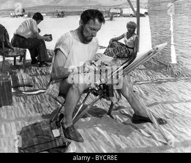 PETER CUSHING English actor during a break in filming Alexander The Great in Spain in 1956 - Stock Photo