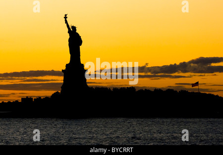The Statue of Liberty at Sunset - Stock Photo