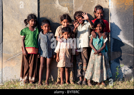 Happy young poor lower caste Indian street children smiling. Andhra Pradesh, India - Stock Photo