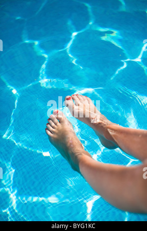 Close Up Of A Mature Woman 39 S Foot With A Glass Of Lemon Juice Beside Stock Photo Royalty Free