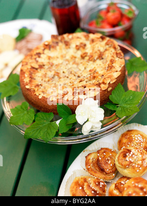 Close-up of fresh cake and cinnamon buns - Stock Photo