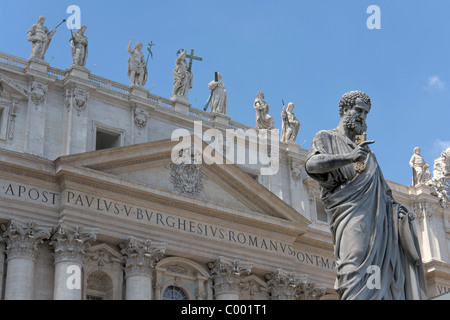 Saint Peter statue and St Peter's basilica - Stock Photo