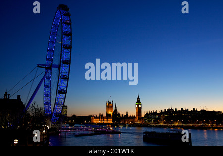 London eye and the houses of parliament at twilight - Stock Photo
