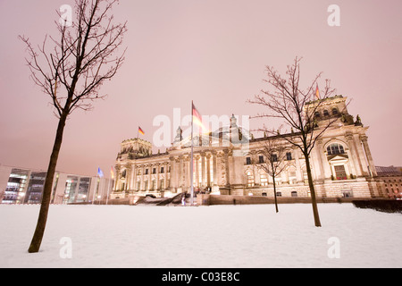 Illuminated Reichstag parliament building in winter, Berlin, Germany, Europe - Stock Photo