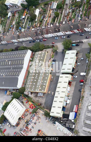 Terrace housing alongside industrial units - Stock Photo