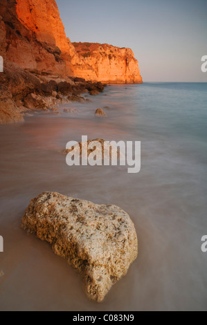 Sunset on the beach in Lagos, Algarve, Portugal, Europe - Stock Photo