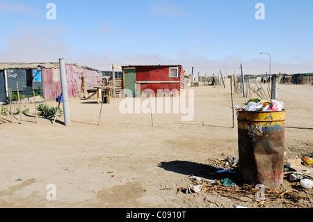 Rubbish and tin shack ut in the Mondesa township, Swakopmund town, Namibia, Africa - Stock Photo