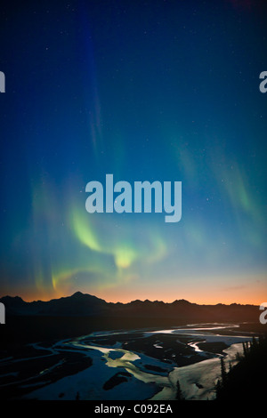 View of Northern Lights in the sky above southside Mount McKinley and the Alaska Range at twilight, Denali State - Stock Photo
