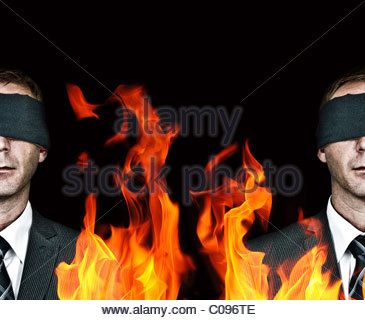 Man blindfolded and fire - Stock Photo