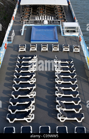 Two rows of aligned empty deckchairs on the deck of a cruise ship on the Rhine, Ruhrort, Duisburg, Ruhr Area - Stock Photo